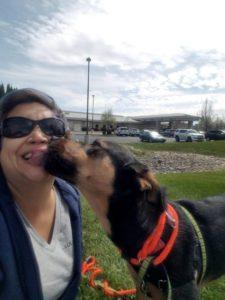 Mia the dog kissing Shawna